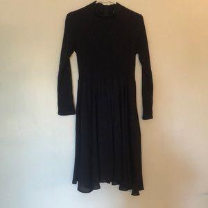A midnight blue sweater dress